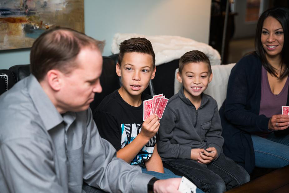 a family of four playing a card game