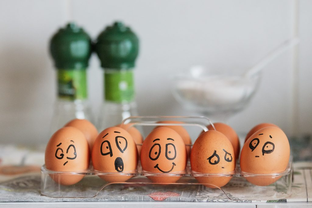 brown eggs with funny faces