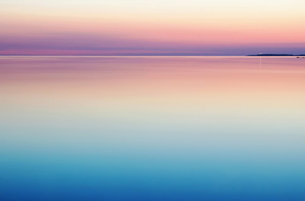 lake and a far off horizon in pastel colors