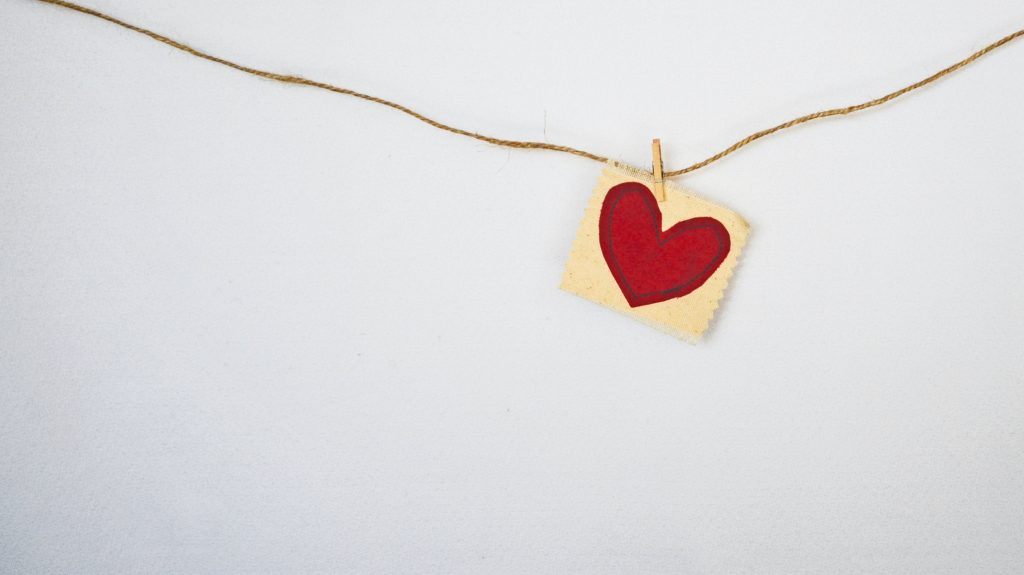 red heart design hung on a string with a clothespin