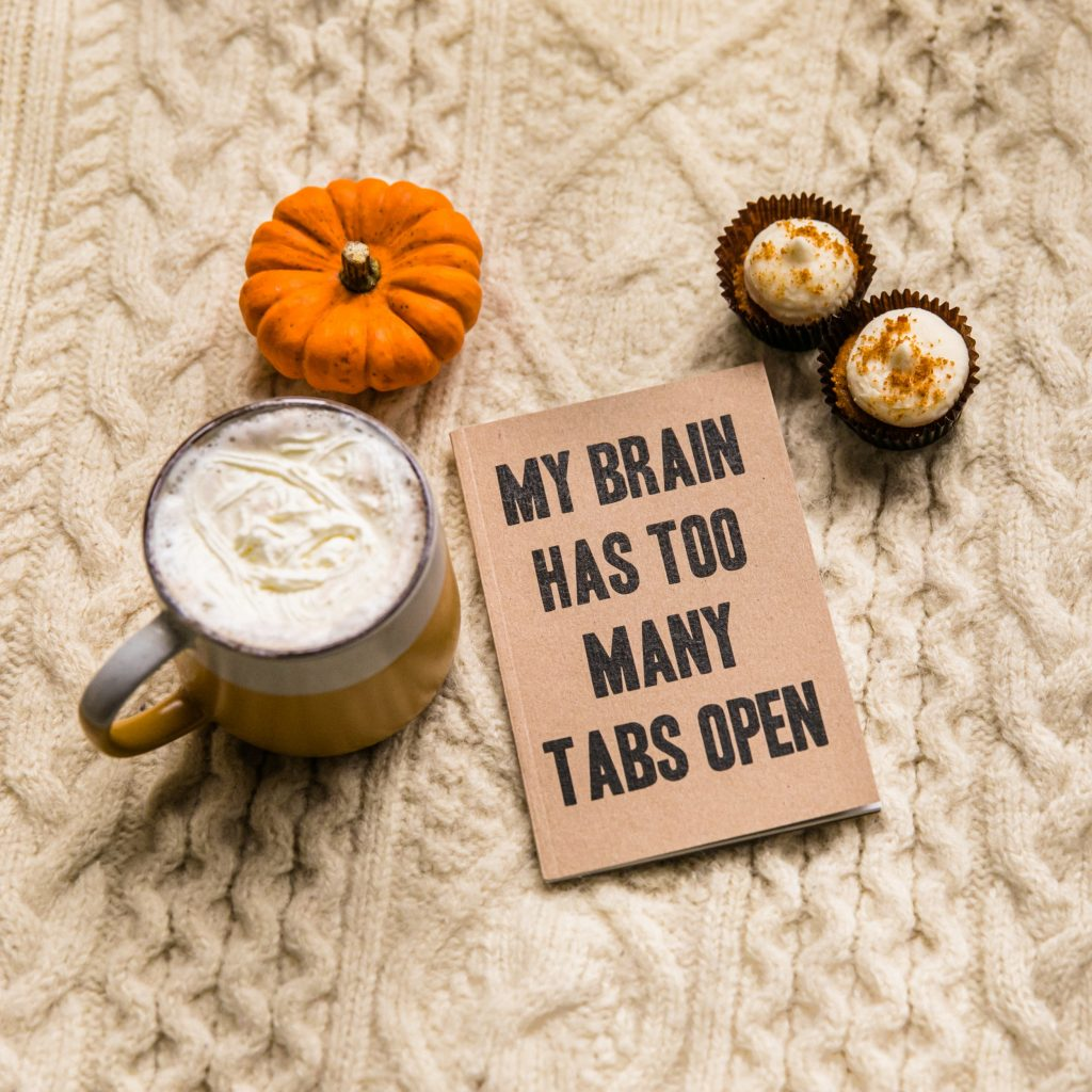 """""""My Brain Has Too Many Tabs Open"""" message surrounded by mini pumpkin, autumn beverage and treats"""